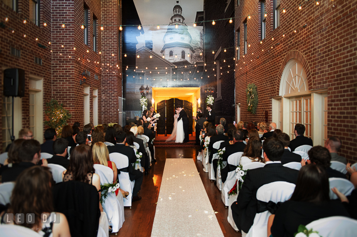 Groom and Bride kissed after pronounced as husband and wife. Historic Inns of Annapolis, Governor Calvert House wedding Maryland, by wedding photographers of Leo Dj Photography. http://leodjphoto.com