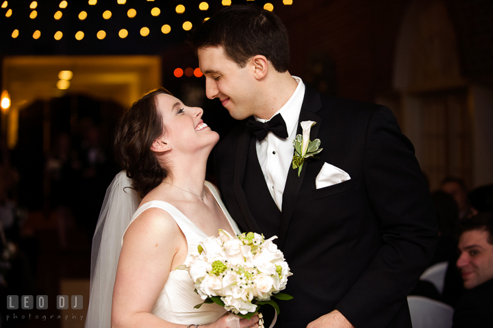 Bride and Groom trying to kiss during the recessional. Historic Inns of Annapolis, Governor Calvert House wedding Maryland, by wedding photographers of Leo Dj Photography. http://leodjphoto.com