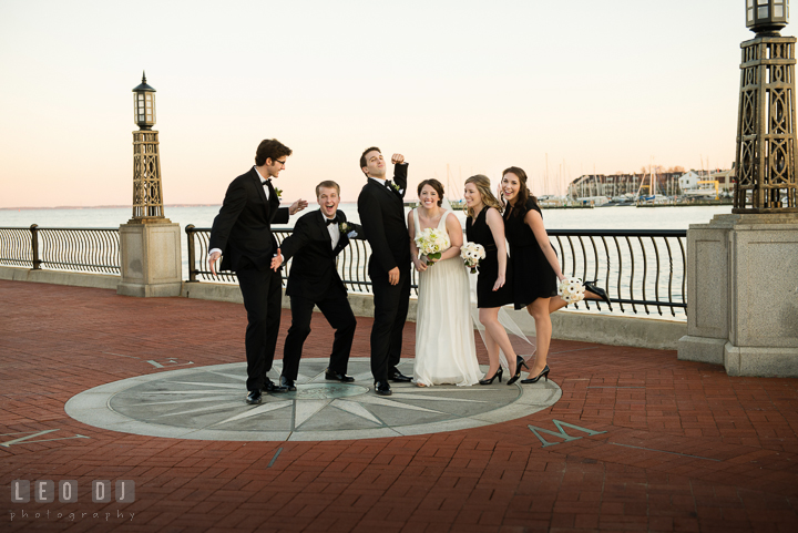 Bride, Groom, Best Man, Maid of Honor, Groomsman, and Bridesmaid doing silly group shot pose. Historic Inns of Annapolis, Governor Calvert House wedding Maryland, by wedding photographers of Leo Dj Photography. http://leodjphoto.com