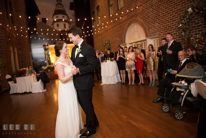First dance of Bride and Groom with guests in the background. Historic Inns of Annapolis, Governor Calvert House wedding Maryland, by wedding photographers of Leo Dj Photography. http://leodjphoto.com
