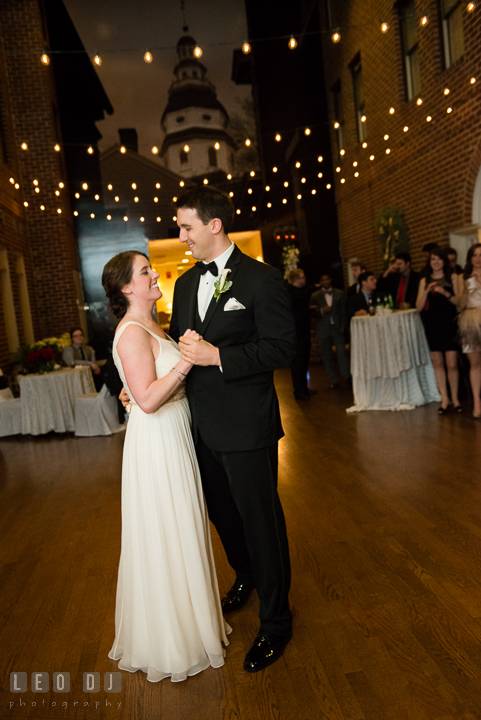 Bride and Groom performing first dance with the Maryland State Capitol building image in the background. Historic Inns of Annapolis, Governor Calvert House wedding Maryland, by wedding photographers of Leo Dj Photography. http://leodjphoto.com