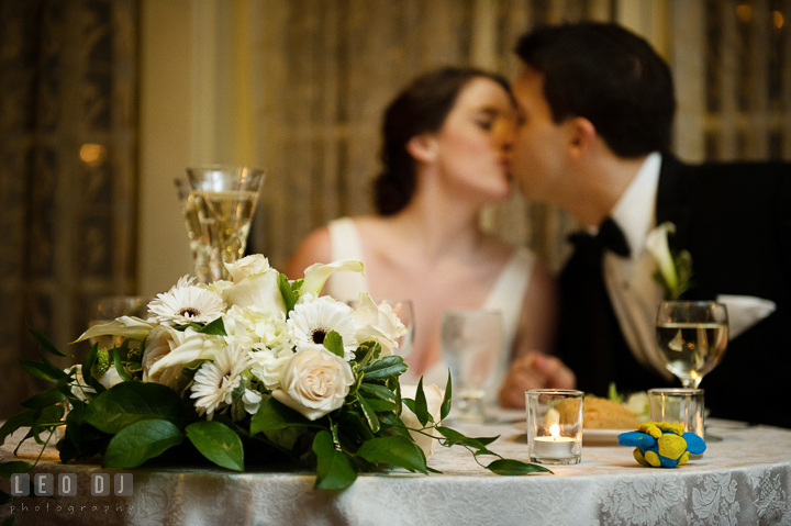 Bride and Groom kissing at the sweetheart table. Historic Inns of Annapolis, Governor Calvert House wedding Maryland, by wedding photographers of Leo Dj Photography. http://leodjphoto.com