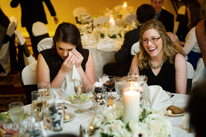 Bridesmaid and Maid of Honor laughing and got emotional listening to toast speech. Historic Inns of Annapolis, Governor Calvert House wedding Maryland, by wedding photographers of Leo Dj Photography. http://leodjphoto.com