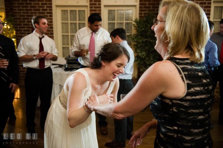 Bride laughing and dancing with Mother of Bride. Historic Inns of Annapolis, Governor Calvert House wedding Maryland, by wedding photographers of Leo Dj Photography. http://leodjphoto.com