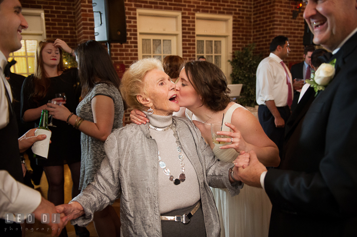 Bride kissed Grandmother on the cheeck during open dance. Historic Inns of Annapolis, Governor Calvert House wedding Maryland, by wedding photographers of Leo Dj Photography. http://leodjphoto.com