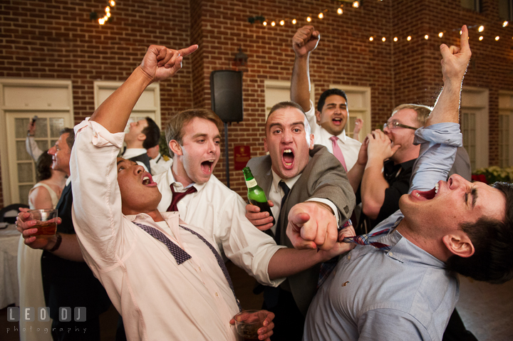 Guys singing loud and acting goofy and crazy during open dance. Historic Inns of Annapolis, Governor Calvert House wedding Maryland, by wedding photographers of Leo Dj Photography. http://leodjphoto.com