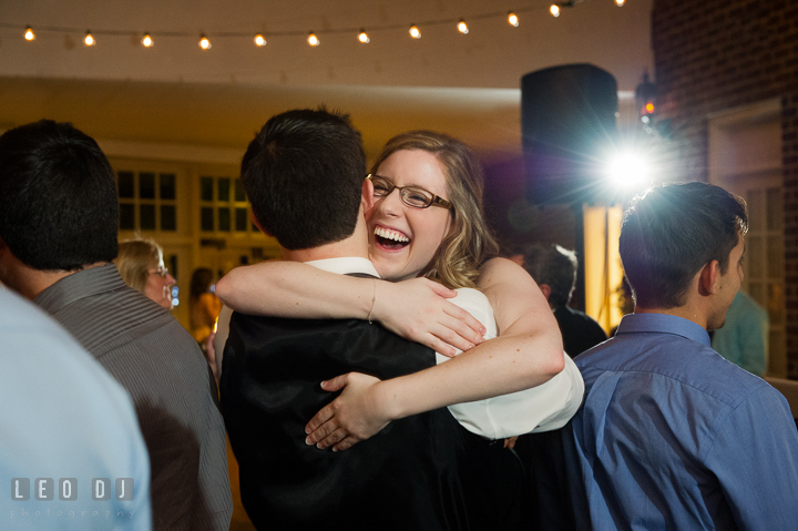 Bride's sister laughing and hugging her fiancé. Historic Inns of Annapolis, Governor Calvert House wedding Maryland, by wedding photographers of Leo Dj Photography. http://leodjphoto.com