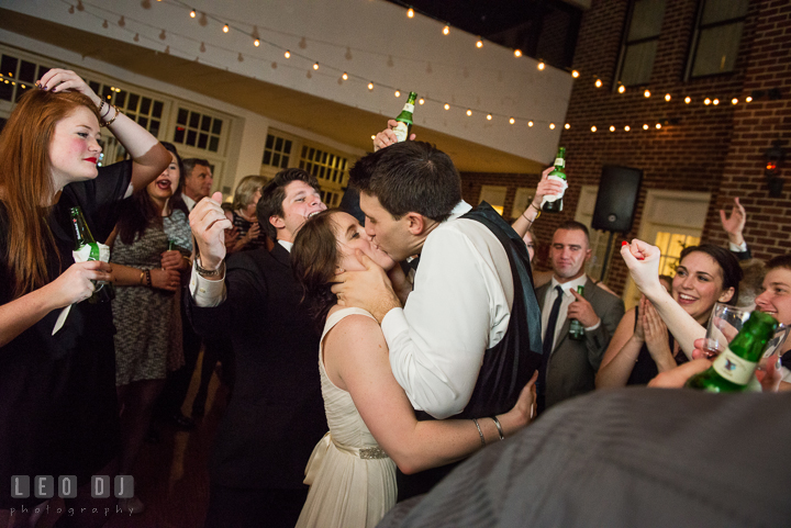 Bride and Groom kissing while dancing in a circle of their guests. Historic Inns of Annapolis, Governor Calvert House wedding Maryland, by wedding photographers of Leo Dj Photography. http://leodjphoto.com