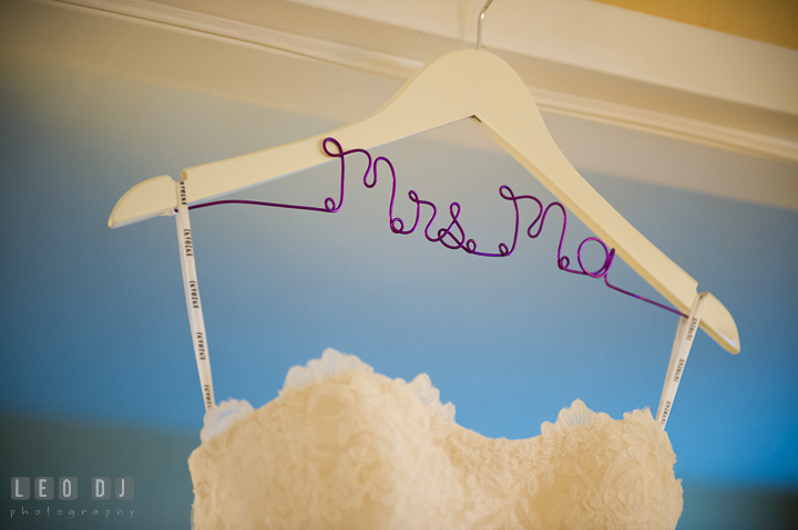 Wedding dress hanged on custom made hanger with last name. Falls Church Virginia 2941 Restaurant wedding ceremony photo, by wedding photographers of Leo Dj Photography. http://leodjphoto.com