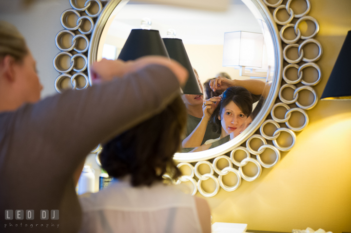 Reflection in mirror of Bride getting her hair done. Falls Church Virginia 2941 Restaurant wedding ceremony photo, by wedding photographers of Leo Dj Photography. http://leodjphoto.com