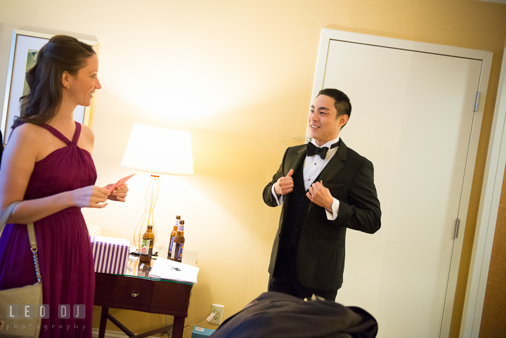 Groom talking to Maid of Honor receiving card and gift from Bride. Falls Church Virginia 2941 Restaurant wedding ceremony photo, by wedding photographers of Leo Dj Photography. http://leodjphoto.com