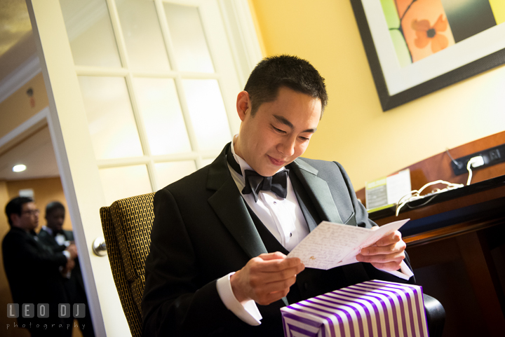 Groom opening and reading card from Bride. Falls Church Virginia 2941 Restaurant wedding ceremony photo, by wedding photographers of Leo Dj Photography. http://leodjphoto.com