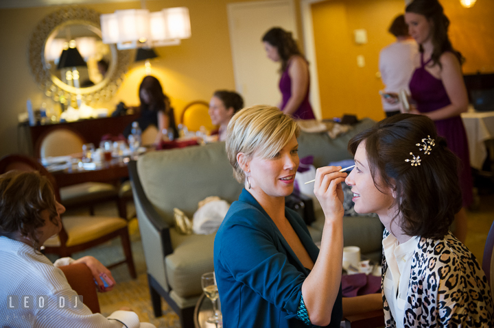Bride getting her make up done. Falls Church Virginia 2941 Restaurant wedding ceremony photo, by wedding photographers of Leo Dj Photography. http://leodjphoto.com
