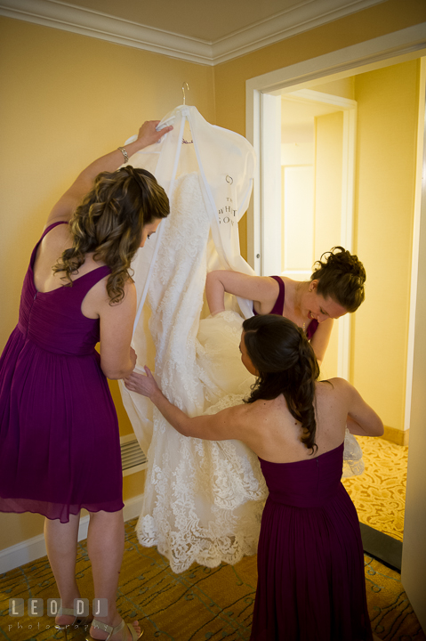 Maid of Honor and Bridesmaids at hotel packing wedding dress to go to venue. Falls Church Virginia 2941 Restaurant wedding ceremony photo, by wedding photographers of Leo Dj Photography. http://leodjphoto.com