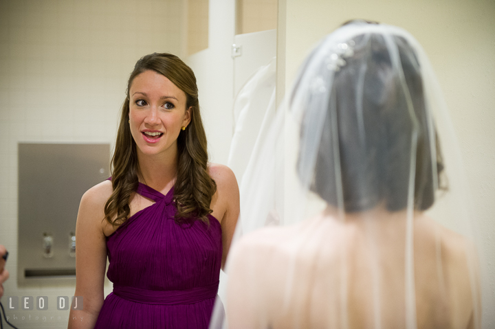 Maid of Honor talking to Bride. Falls Church Virginia 2941 Restaurant wedding ceremony photo, by wedding photographers of Leo Dj Photography. http://leodjphoto.com