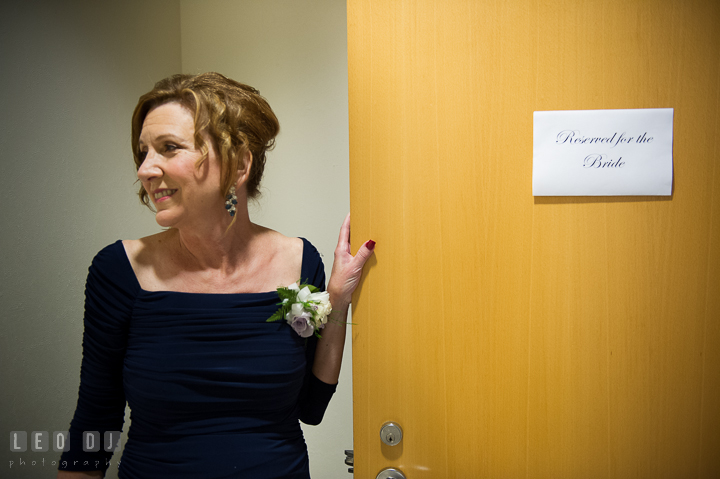 Mother of Bride holding the room door with sign Reserved for the Bride. Falls Church Virginia 2941 Restaurant wedding ceremony photo, by wedding photographers of Leo Dj Photography. http://leodjphoto.com