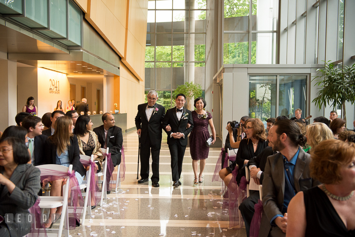 Groom walking down the isle during procession, escorted by Father and Mother of Groom. Falls Church Virginia 2941 Restaurant wedding ceremony photo, by wedding photographers of Leo Dj Photography. http://leodjphoto.com