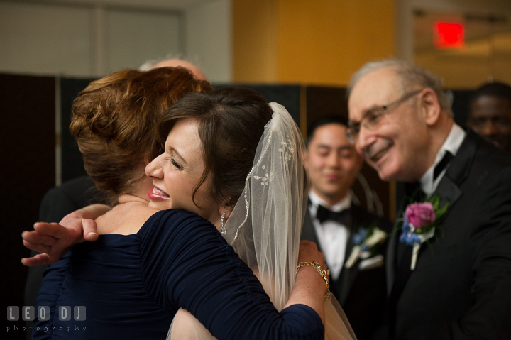 Mother of Bride hugging and giving away daughter. Falls Church Virginia 2941 Restaurant wedding ceremony photo, by wedding photographers of Leo Dj Photography. http://leodjphoto.com