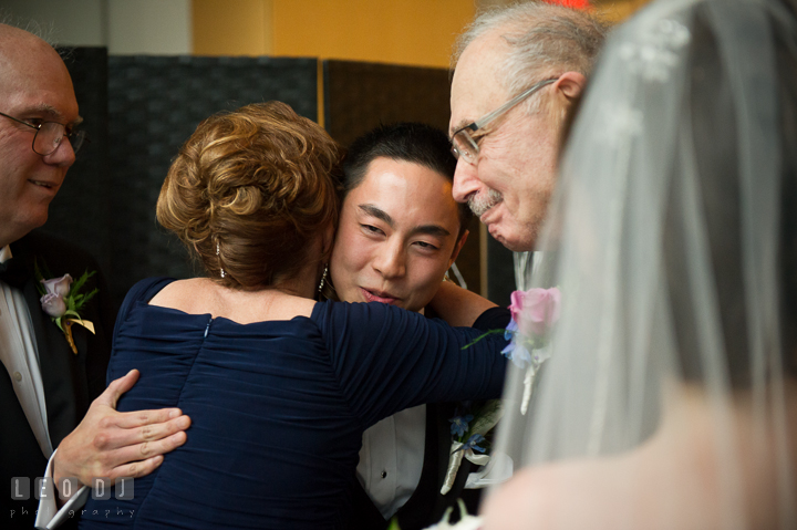 Mother of Bride hugging Groom. Falls Church Virginia 2941 Restaurant wedding ceremony photo, by wedding photographers of Leo Dj Photography. http://leodjphoto.com