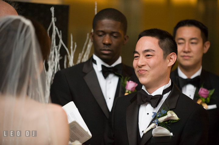 Groom smiling to Bride listening to her sweet and funny vow. Falls Church Virginia 2941 Restaurant wedding ceremony photo, by wedding photographers of Leo Dj Photography. http://leodjphoto.com