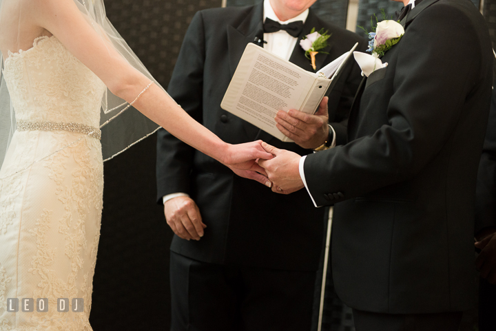 Bride and Groom holding hands during the ceremony. Falls Church Virginia 2941 Restaurant wedding ceremony photo, by wedding photographers of Leo Dj Photography. http://leodjphoto.com