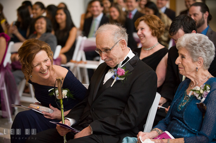 Parents and grandparents laughing listening to Bride and Groom's funny and sweet vows. Falls Church Virginia 2941 Restaurant wedding ceremony photo, by wedding photographers of Leo Dj Photography. http://leodjphoto.com