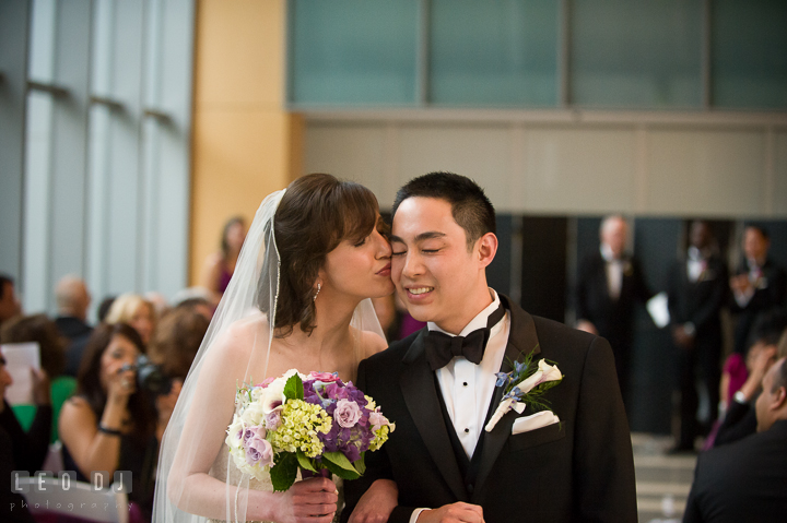 Bride kissed Groom's cheek while walking out of the aisle. Falls Church Virginia 2941 Restaurant wedding ceremony photo, by wedding photographers of Leo Dj Photography. http://leodjphoto.com