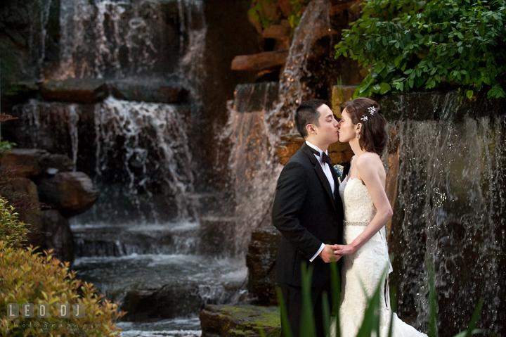 Bride and Groom kissing. Falls Church Virginia 2941 Restaurant wedding reception photo, by wedding photographers of Leo Dj Photography. http://leodjphoto.com