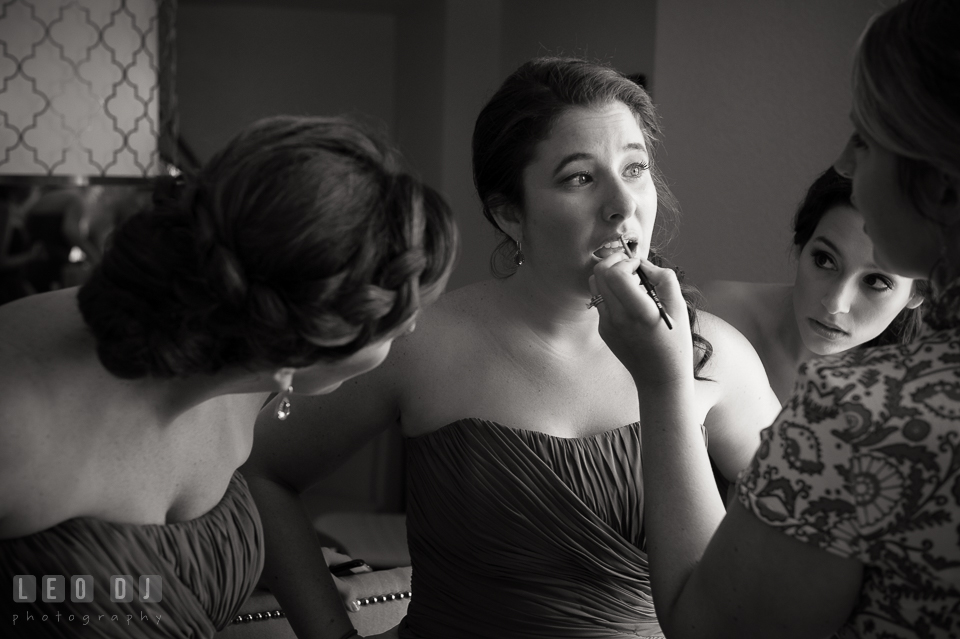 Maid of honor and bridesmaid watching another bridesmaid getting make up. Loews Annapolis Hotel Maryland wedding, by wedding photographers of Leo Dj Photography. http://leodjphoto.com