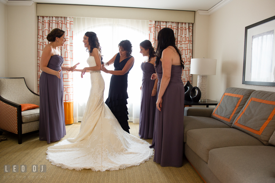 Mother of Bride help daughter zip up wedding gown. Loews Annapolis Hotel Maryland wedding, by wedding photographers of Leo Dj Photography. http://leodjphoto.com