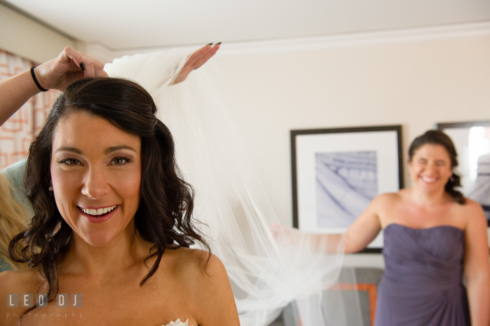 Mother of Bride put veil on daughter. Loews Annapolis Hotel Maryland wedding, by wedding photographers of Leo Dj Photography. http://leodjphoto.com