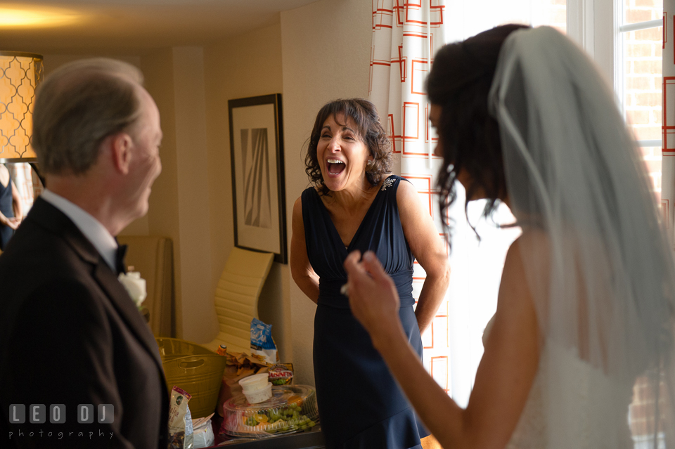 Mother of Bride laughing during daughter first look with Father. Loews Annapolis Hotel Maryland wedding, by wedding photographers of Leo Dj Photography. http://leodjphoto.com