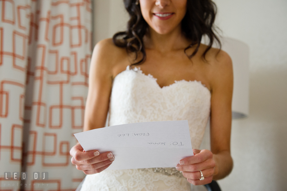 Bride reading letter from Groom during getting ready. Loews Annapolis Hotel Maryland wedding, by wedding photographers of Leo Dj Photography. http://leodjphoto.com