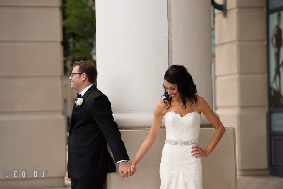 Bride and Groom holding hands and smiling before their first look. Loews Annapolis Hotel Maryland wedding, by wedding photographers of Leo Dj Photography. http://leodjphoto.com