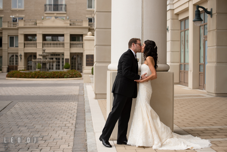 Bride and Groom kissing during their first glance. Loews Annapolis Hotel Maryland wedding, by wedding photographers of Leo Dj Photography. http://leodjphoto.com