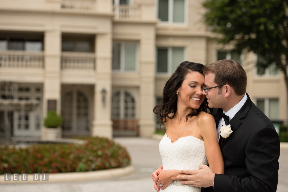 Bride cuddling with Groom. Loews Annapolis Hotel Maryland wedding, by wedding photographers of Leo Dj Photography. http://leodjphoto.com