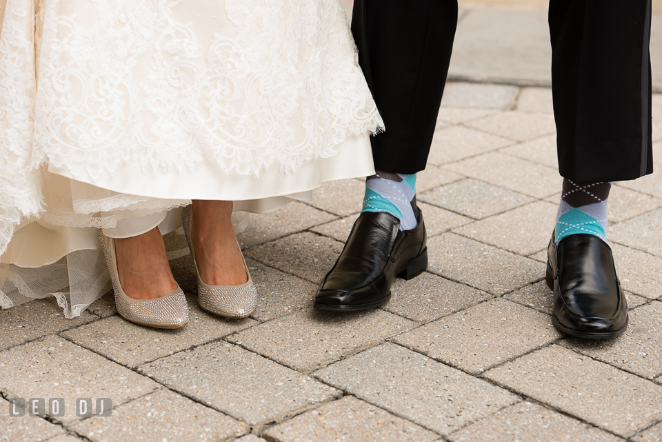 Close up view of Bride and Groom's shoes and socks. Loews Annapolis Hotel Maryland wedding, by wedding photographers of Leo Dj Photography. http://leodjphoto.com