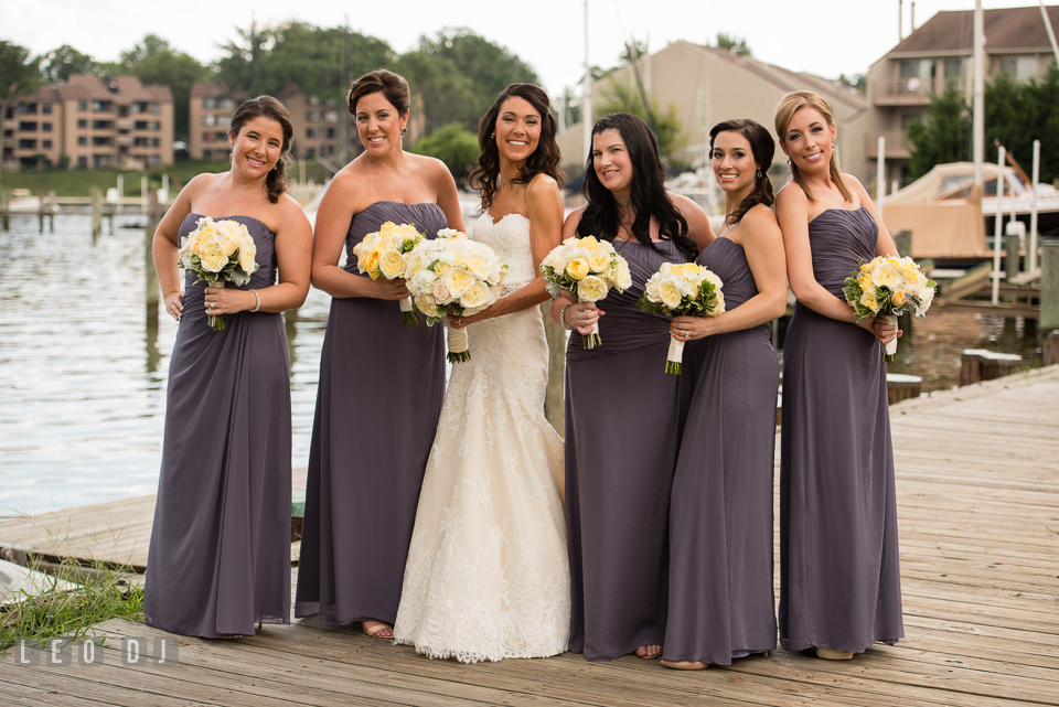 Bride posing with Maid of Honor and Bridesmaids with their bouquets. Loews Annapolis Hotel Maryland wedding, by wedding photographers of Leo Dj Photography. http://leodjphoto.com