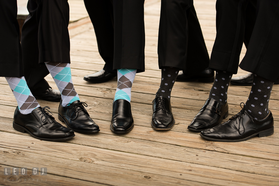 Groom, Best Man, and Groomsmen showing their socks. Loews Annapolis Hotel Maryland wedding, by wedding photographers of Leo Dj Photography. http://leodjphoto.com