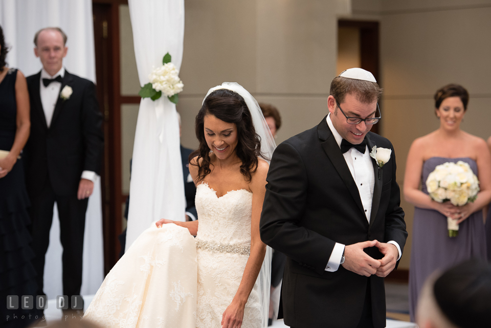 Bride circling Groom during circling ritual in Jewish wedding ceremony. Loews Annapolis Hotel Maryland wedding, by wedding photographers of Leo Dj Photography. http://leodjphoto.com