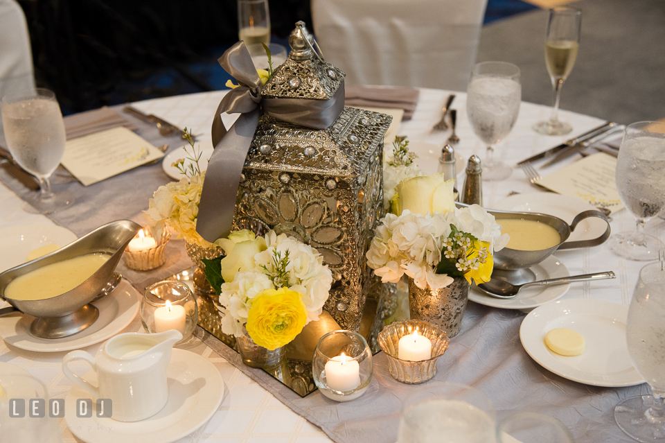 Table centerpiece of luxurious beaded lantern and flowers by Violets Florists by Connie Clark. Loews Annapolis Hotel Maryland wedding, by wedding photographers of Leo Dj Photography. http://leodjphoto.com