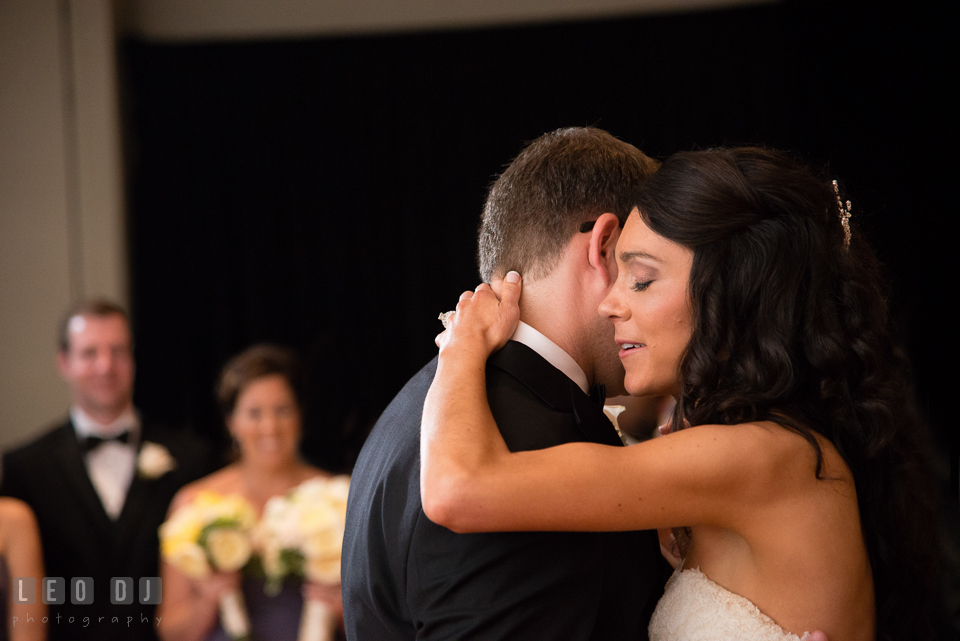 Bride hugging Groom during first dance. Loews Annapolis Hotel Maryland wedding, by wedding photographers of Leo Dj Photography. http://leodjphoto.com