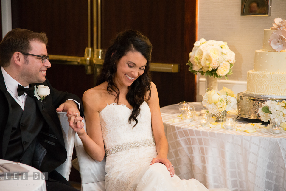 Bride and Groom laughing during toast speech. Loews Annapolis Hotel Maryland wedding, by wedding photographers of Leo Dj Photography. http://leodjphoto.com