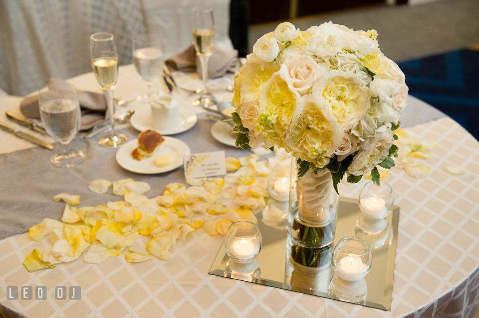 Setup of sweetheart table with Bride's flower bouquet by Violets Florists by Connie Clark. Loews Annapolis Hotel Maryland wedding, by wedding photographers of Leo Dj Photography. http://leodjphoto.com