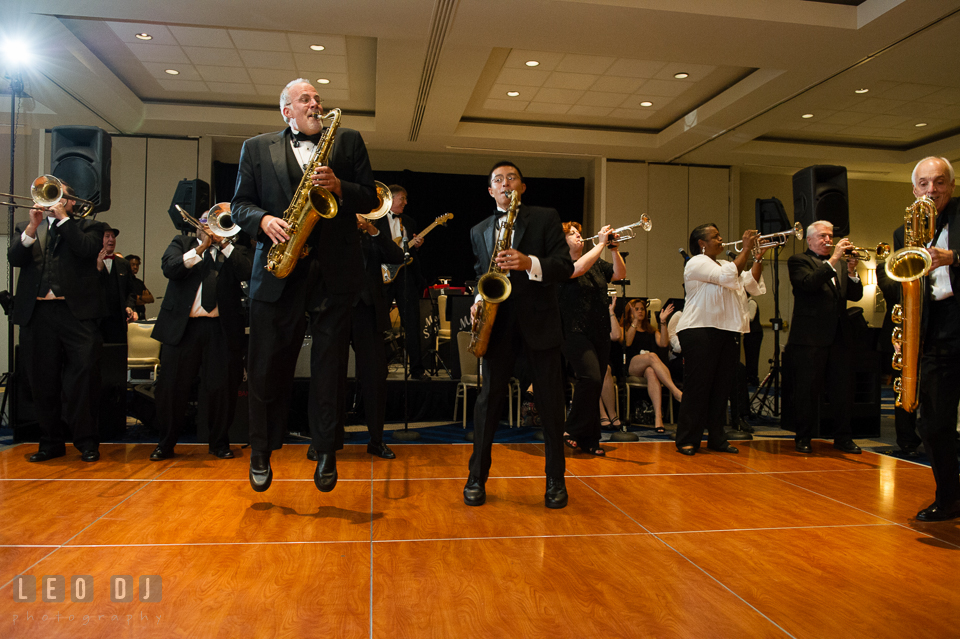Saxophone players from Mood Swings Band jumping while performing live. Loews Annapolis Hotel Maryland wedding, by wedding photographers of Leo Dj Photography. http://leodjphoto.com