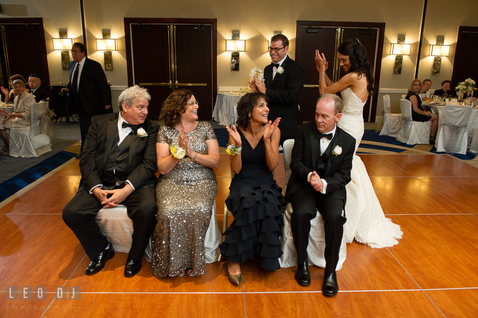 Parents sitting and circled by Bride and Groom during the Mezinke Tanz ritual . Loews Annapolis Hotel Maryland wedding, by wedding photographers of Leo Dj Photography. http://leodjphoto.com