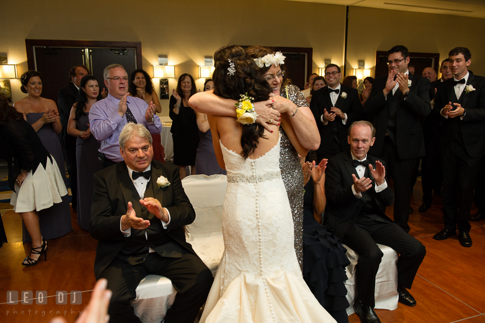 Mother of Groom hugging Bride during the crowning ritual. Loews Annapolis Hotel Maryland wedding, by wedding photographers of Leo Dj Photography. http://leodjphoto.com