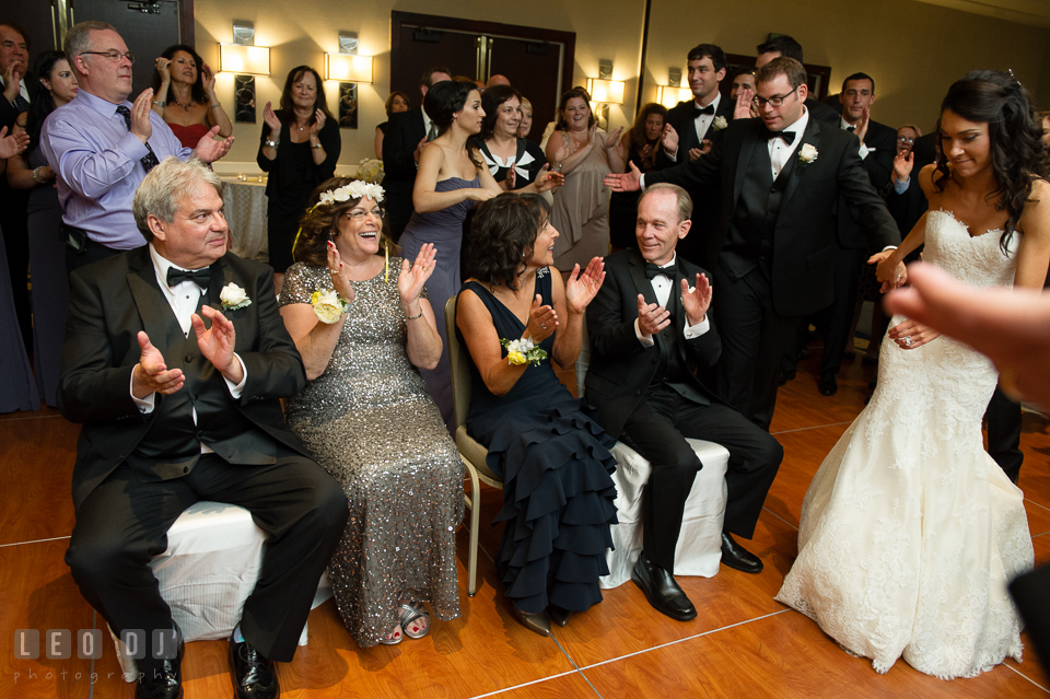Guests circling parents during the flower crowning ritual Mezinke Tanz. Loews Annapolis Hotel Maryland wedding, by wedding photographers of Leo Dj Photography. http://leodjphoto.com