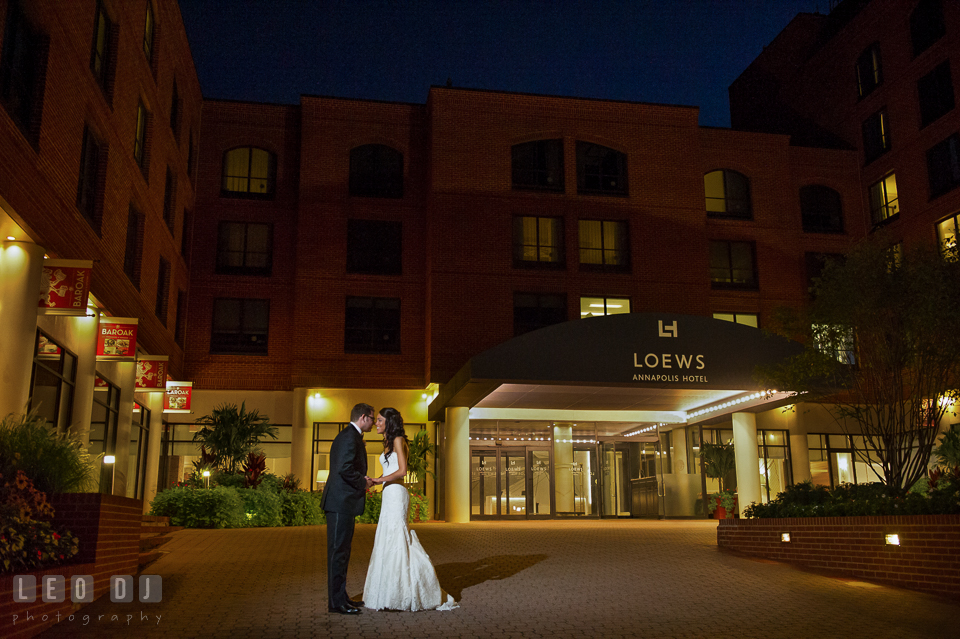 Bride and Groom almost kissing in front of the hotel entrance. Loews Annapolis Hotel Maryland wedding, by wedding photographers of Leo Dj Photography. http://leodjphoto.com