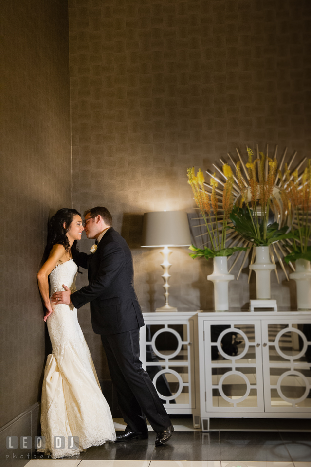 Bride and Groom leaning on a wall, almost kissing. Loews Annapolis Hotel Maryland wedding, by wedding photographers of Leo Dj Photography. http://leodjphoto.com